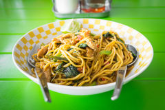 Stir fried yellow noodles with basil leaf Stock Photo