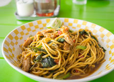 Stir fried yellow noodles with basil leaf Stock Photography