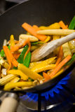 Stir-fry #3. Close-up of gas burner and wok with stir-fried vegetables stock photos