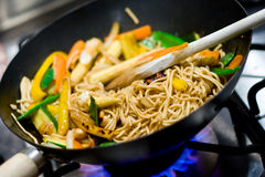 Stir-fry #4. Close-up of gas burner and wok with stir-fried vegetables stock image