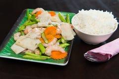Stir fry baby coconut with asparagus Stock Photos