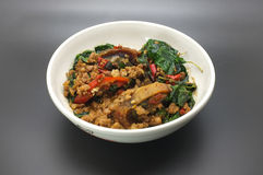Stir fry basil leaves with minced pork and preserved egg Stock Image