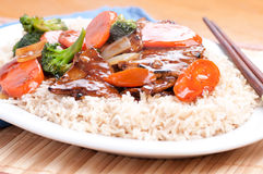 Stir fry beef. Beef with broccoli and carrot stir fry over brown rice Stock Photos