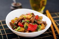 Stir fry beef, sweet peppers, zucchini. And green apples Stock Images
