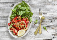 Stir fry of chicken breast and sweet red pepper and fresh spinach Royalty Free Stock Image