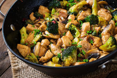 Stir fry chicken with broccoli and mushrooms. Stock Photo