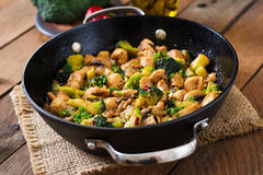 Stir fry chicken with broccoli and mushrooms. Stock Photos