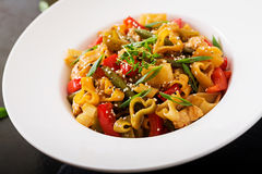 Stir Fry from chicken fillet, green beans and paprika with past Royalty Free Stock Photos