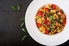 Stir Fry from chicken fillet, green beans and paprika with pasta Stock Image