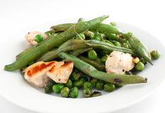 Stir fry chicken with green peas and beans. Closeup Stock Photography