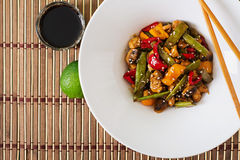 Stir fry with chicken, mushrooms, green beans and sweet peppers. Royalty Free Stock Photos