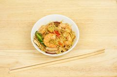 Stir fry and chopsticks royalty free stock images