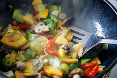 Stir fry cooking, blurred, bright, sizzling and steamy for actio Royalty Free Stock Image
