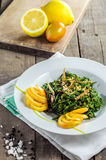 Stir fry fern with fried fish. On table stock photos