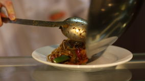 Stir-fry in foot court stock video footage