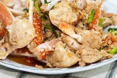 Stir fry garlic and crab. Hot plate stir fry garlic and crab Royalty Free Stock Photo