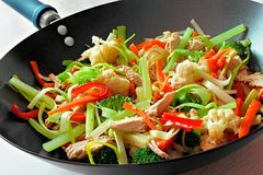 Stir fry. With mixed vegetables and chicken in a wok Stock Photo