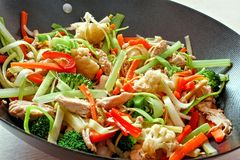 Stir fry. With mixed vegetables and chicken in a wok Royalty Free Stock Photos