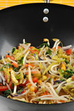 Stir fry with oil in a wok Stock Photography