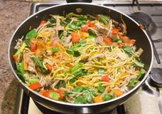 Stir fry in a pan royalty free stock images