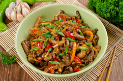 Stir fry pork, sweet peppers, onions and garlic Royalty Free Stock Photos