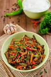 Stir fry pork, sweet peppers, onions and garlic Stock Photos