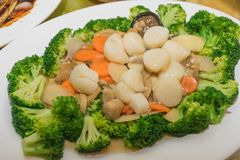 Stir Fry Scallops Served With Broccoli royalty free stock image