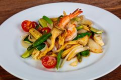 Stir fry with seafood. And vegetables stock images