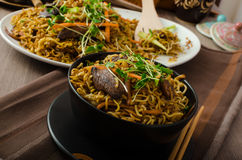 Stir Fry Singapore Noodles. With bio herbs and microgreens, vegetable Stock Image