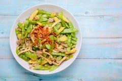 Stir Fry Snow Peas on blue wood background stock photo