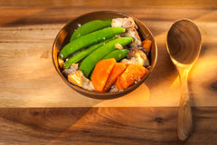 Stir-fry Snow Peas with Carrot with Shiitake and pork. On the table Royalty Free Stock Image