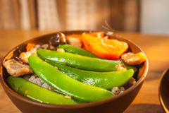 Stir-fry Snow Peas with Carrot with Shiitake and pork. On wood table Royalty Free Stock Photo