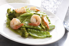 Stir-fry a snow peas shrimp dish. Chinese cuisine stir fry snow peas and broccoli with shrimp royalty free stock images