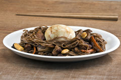 Stir fry soba noodles with tea egg Royalty Free Stock Photos