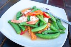 Stir fry sweet peas with prawns Stock Photos