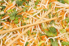 Stir fry vegetables and chop sticks. Stir fry vegetables with chop sticks laid on top Royalty Free Stock Photography