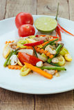 Stir fry vegetables in white dish on wood royalty free stock photos