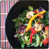 Stir fry wok. A wok containing a bright and colourful sweet and sour stir fry meal Royalty Free Stock Image