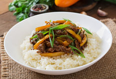 Stir frying beef with sweet peppers, green beans. And rice Royalty Free Stock Photos