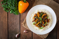 Stir frying beef with sweet peppers, green beans Stock Photos