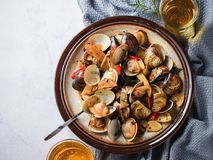 Stir-frying Ginger and clams at high heat to bring forth the savory aroma with sesame oil in recipe stock photo