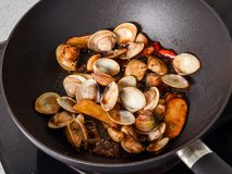 Stir-frying Ginger and clams at high heat to bring forth the savory aroma with sesame oil. In recipe Stock Photo