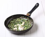 Stir frying spring onion and garlic Royalty Free Stock Photo