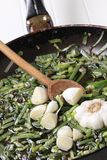 Stir frying spring onion and garlic Stock Image