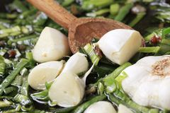 Stir frying spring onion and garlic Stock Images
