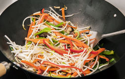 Stir frying vegetables in a wok Stock Images