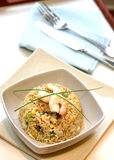 Stirfried egg friend rice with prawn. A bowl of prawn, mushroom and egg stir fried rice garnish with chives Stock Images