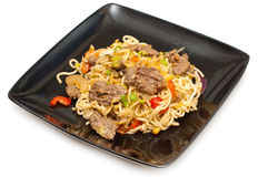 Stirfry beef chow mein. With fresh Chinese vegetables royalty free stock photos