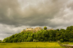 Stirling Castle. Illuminated in sunshine against a stormy grey sky Royalty Free Stock Photo