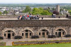 Guided tour with unknown tourists visiting Stirling Castle in Scotland stock photo